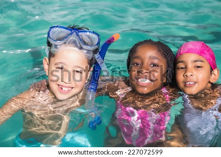 Cute little kids swimming in the pool at the leisure center - stock photo