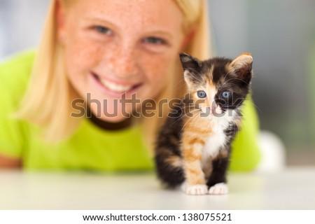 cute little kitten and teen girl closeup - stock photo