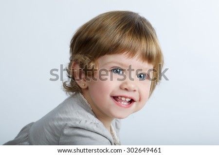 Cute little laughing girl portrait on white - stock photo