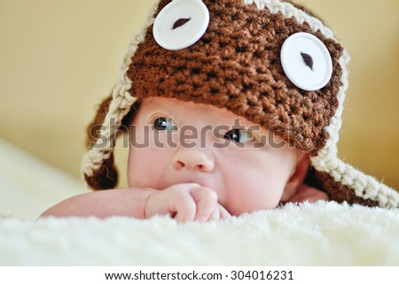 cute little newborn baby wearing funny hat - stock photo