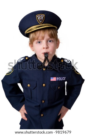 Cute little policegirl sternly looking at camera while blowing her whistle. - stock photo