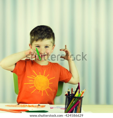 Cute little preschooler child drawing at home. - stock photo