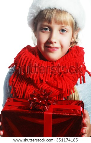 Cute little preschooler girl in red santa hat with gift box isolated on white, Christmas postcard - stock photo