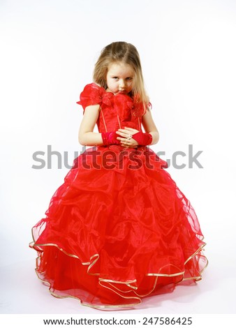 Cute little princess dressed in red dancing. Isolated on white background. Children fashion. - stock photo