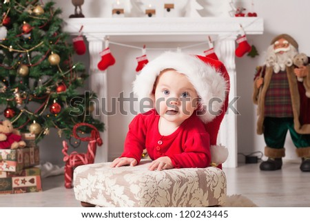 Cute little santa baby with New years gifts.Use it for a child, parenting or love concept. Happy new year - stock photo