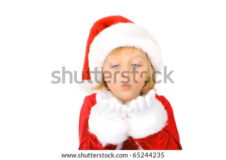 Cute little Santa Claus is blowing snowflake - stock photo