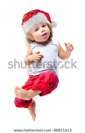 Cute little Santa helper in red pants, high angle view, isolated on white background - stock photo
