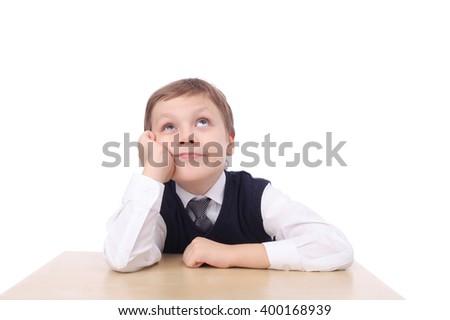 cute little school boy looking up - stock photo