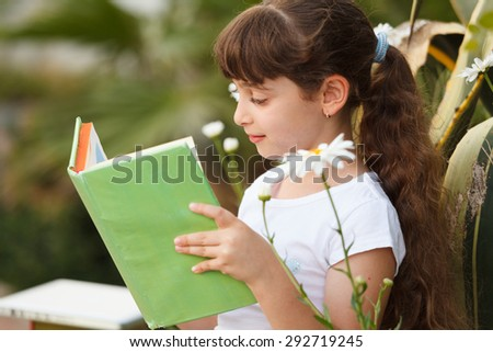 Cute Little School Girl  Reading Book - stock photo