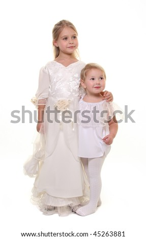 cute little sisters isolated on white - stock photo