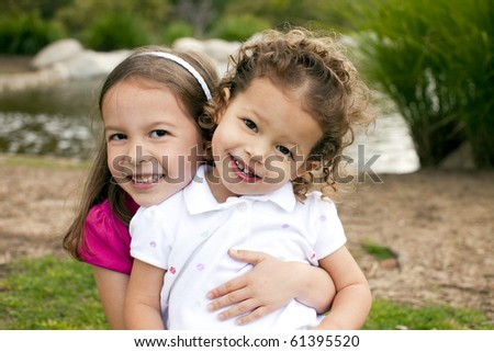 Cute little sisters playing outside