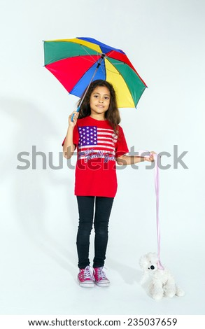 Cute little smiling afro-american girl with umbrella and toy isolated on white - stock photo