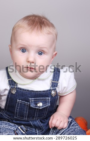 cute little surprised baby closeup - stock photo