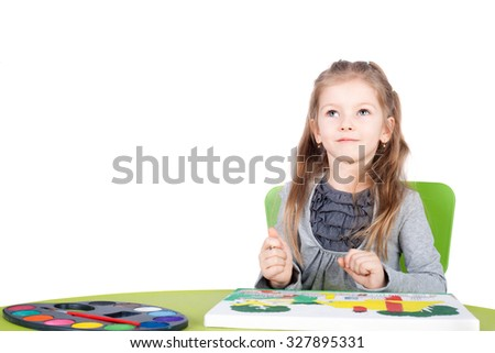 cute little talented girl painting - stock photo