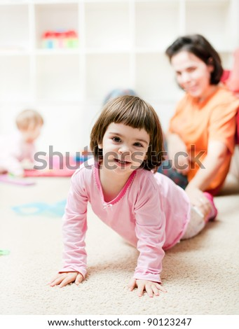 Cute little toddler girl having fun at home