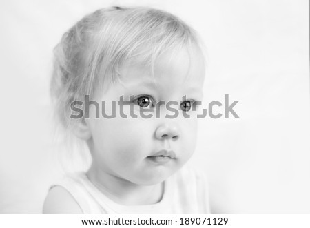 cute little toddler girl in high key technique