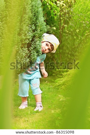 Cute little toddler girl playing in the garden