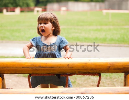 Cute little toddler girl playing outdoors - stock photo