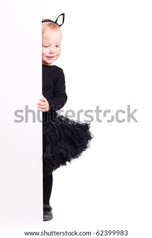Cute little toddler girl with banner dressed for Halloween as black cat - stock photo
