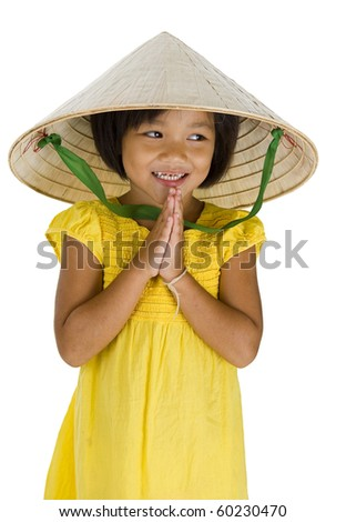 cute little uptown girl with vietnamese style hat and typical asian welcome expression, isolated on white background - stock photo