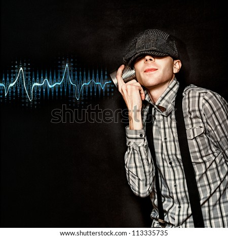 Cute Little Vintage Boy Playing With Tin Can Phone While Listening To Frequency Vibration Waves Being Relayed From A Communication Transmission Signal - stock photo