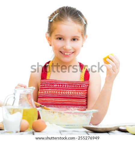 cute llittle girl cooking cakes isolated on a white background - stock photo