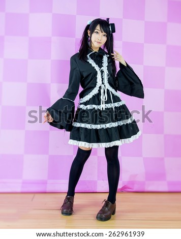 cute lolita dress in pink background - stock photo