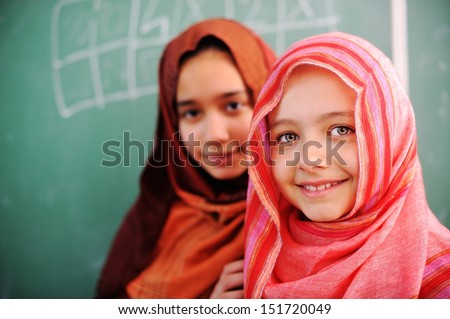 Cute lovely Arabic school children at classroom having education activities - stock photo