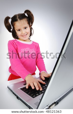 Cute lovely girl on big large laptop - stock photo