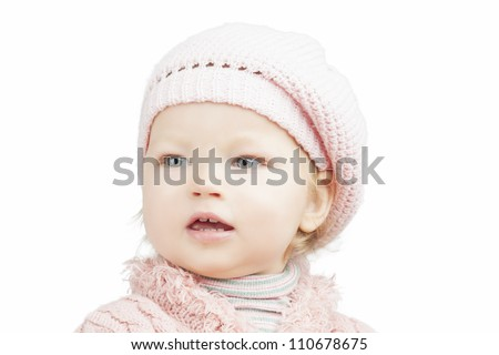 cute lovely portrait of little caucasian toddler standing in cap isolated over white background