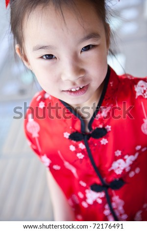 cute lovely sweet asian kid girl with smiling face in home background - stock photo
