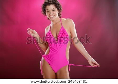 Cute magenta swimsuit - stock photo