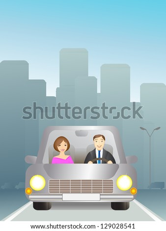 Cute man and woman in car on the road - stock photo
