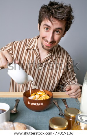 Cute man eating fruit salad - stock photo