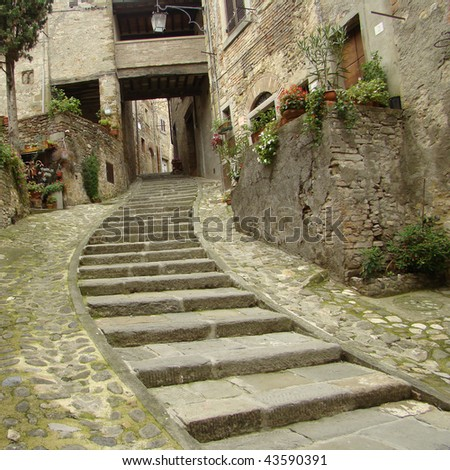 cute medieval street in tuscan small town Anghiari, Italy, Europe - stock photo