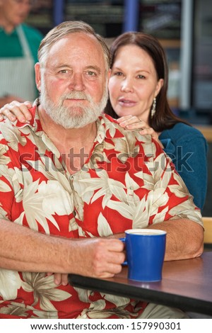 Cute middle aged Caucasian couple in cafe - stock photo