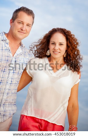 Cute middle aged couple walking portrait with focus on the wife - stock photo