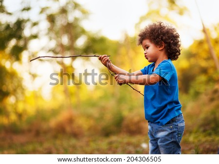 Cute mixed race boy, in nature - stock photo