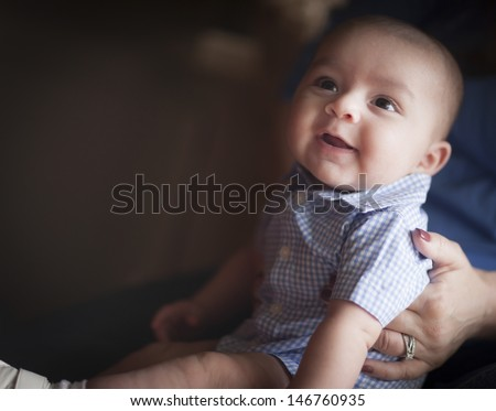 Cute Mixed Race Infant Having Fun with His Parents. - stock photo