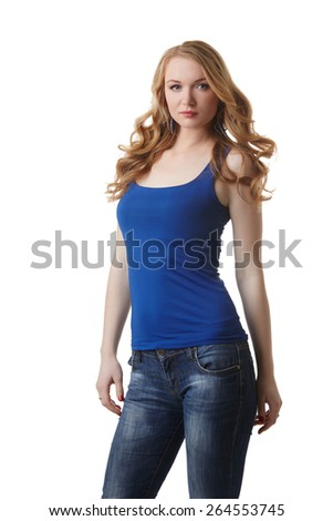 Cute model posing in blue t-shirt and jeans - stock photo
