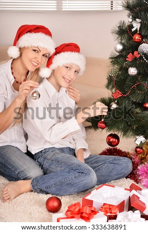 Cute mom and son in santa hats