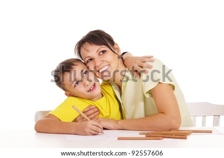 cute mom drawing with son at table