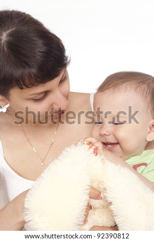 cute mom holding her cute baby on white