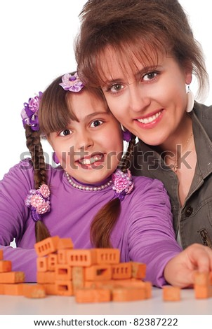 cute mom plays with her little girl - stock photo