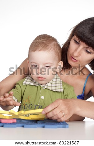 cute mom with her son playing at table