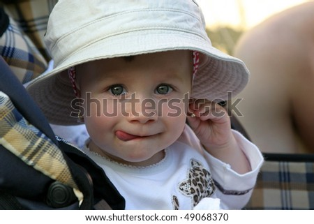 Cute 11 months old baby girl looking at the camera - stock photo