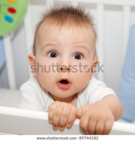 Cute 8 months old baby has something important to tell you - stock photo
