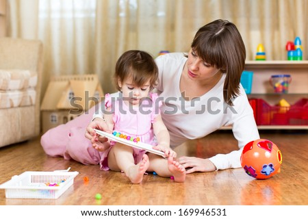 cute mother and kid girl play together - stock photo