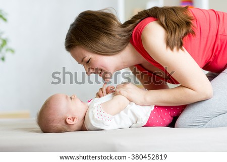 Cute mother with her baby having fun pastime