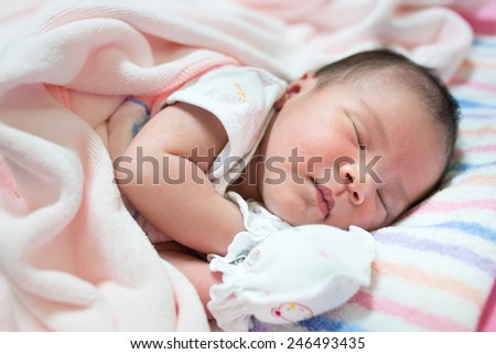 Cute newborn baby - stock photo